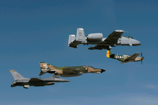 STK102292M © Stocktrek Images, Inc. A P-51 Mustang, an F-4 Phantom, an A-10 Thunderbolt and an F-16 Fighting Falcon in a heritage flight.