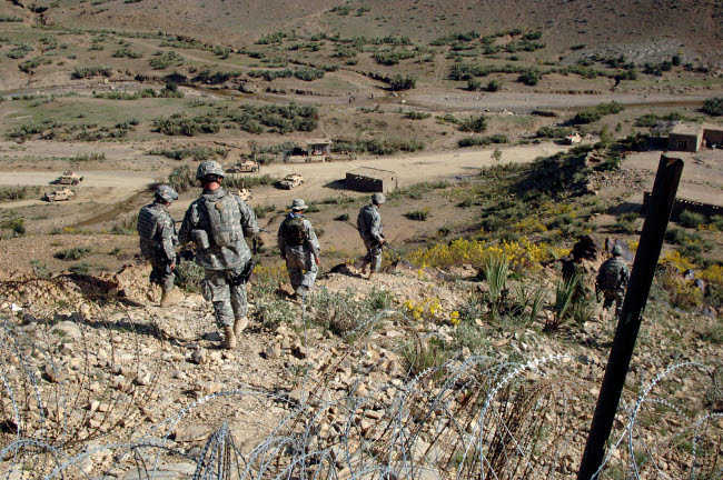 STK102302M © Stocktrek Images, Inc. U.S Army Soldiers walk back to their humvee from a border checkpoint.