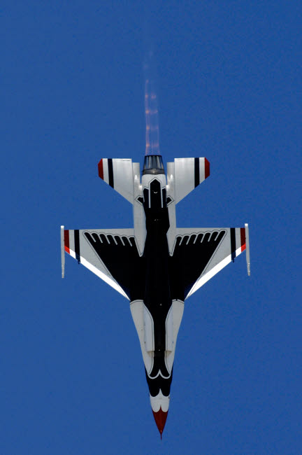 STK102312M © Stocktrek Images, Inc. An F-16 Falcon dives straight down while performing the Split S maneuver.