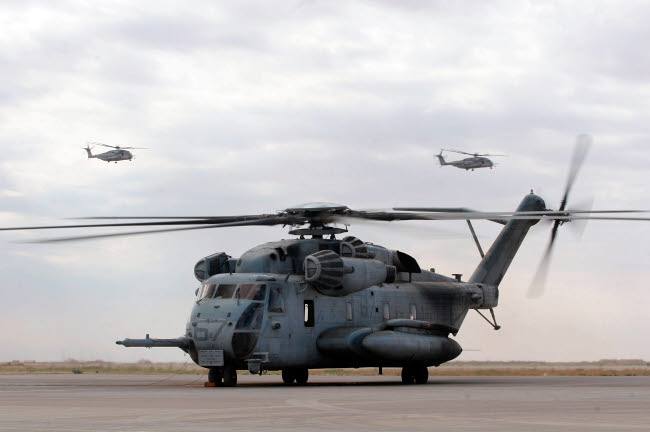 STK102328M © Stocktrek Images, Inc. Two CH-53E Super Stallion helicopters depart Al Asad Air Base, Iraq.