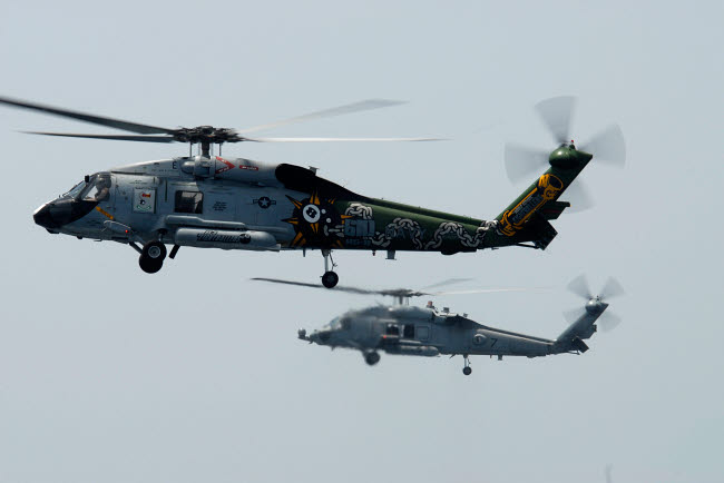 STK102350M © Stocktrek Images, Inc. An SH-60F and HH-60H Seahawk helicopter in flight.
