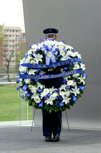 STK102360M © Stocktrek Images, Inc. Airman holds a wreath during a ceremony.