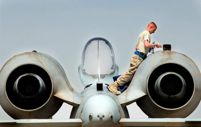 STK102361M © Stocktrek Images, Inc. Airman performs an intake and exhaust inspection on an A-10 Thunderbolt II.