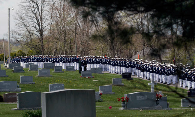 STK102365M © Stocktrek Images, Inc. The regiment of the Virginia Tech Corps of Cadets stands in formation along a cemetery.