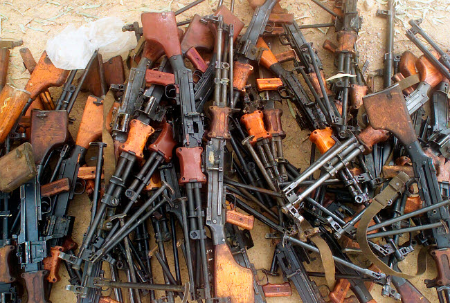 STK102387M © Stocktrek Images, Inc. A captured Fedayeen weapons cache of Russian RPK 74 rifles.