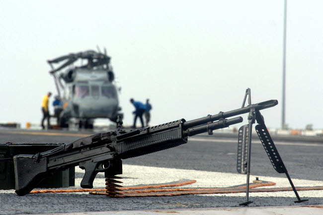 STK102413M © Stocktrek Images, Inc. A U.S. Navy Saco 7.62 mm M60 machine gun sits on the ground.