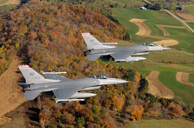 STK102901M © Stocktrek Images, Inc. A two-ship formation of F-16 Fighting Falcons on a routine training mission.