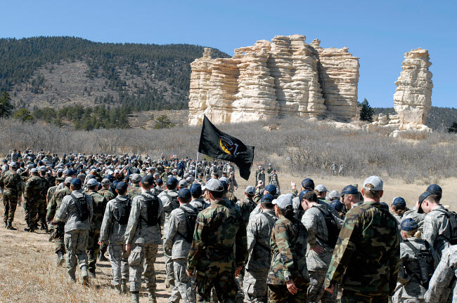 STK102905M © Stocktrek Images, Inc. Fourth-class cadets arrive at Cathedral Rock during Recognitions Run to the Rock.