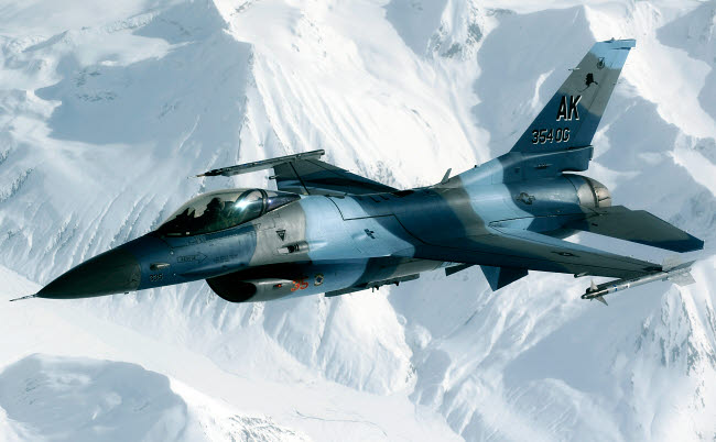 STK102927M © Stocktrek Images, Inc. An F-16 Aggressor disconnectsfrom a KC-10 Extender after being refueled.