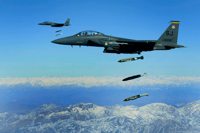 STK103333M © Stocktrek Images, Inc. U.S. Air Force F-15E Strike Eagle aircraft drops 2,000-pound joint direct attack munitions.