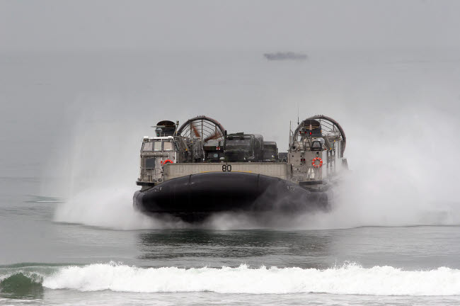 STK103760M © Stocktrek Images, Inc. A landing craft air cushion comes ashore at U.S. Marine Corps Base Camp Pendleton, California