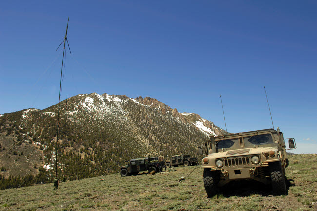 STK103764M © Stocktrek Images, Inc. A Humvee is parked at the re-transmitting site at the Mountain Warfare Training Center in California.