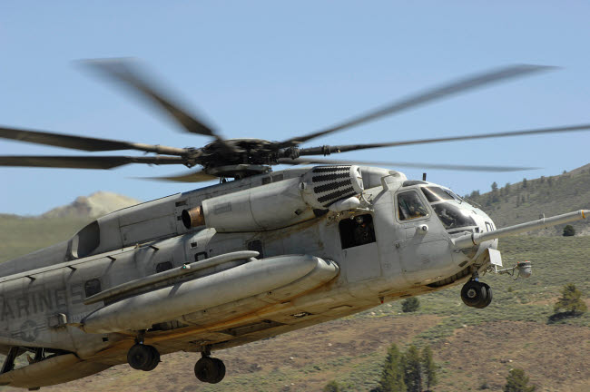 STK103765M © Stocktrek Images, Inc. A CH-53 Super Stallion helicopter lands at the Mountain Warfare Training Center in California.