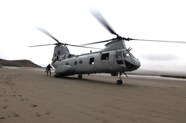 STK103770M © Stocktrek Images, Inc. A CH-46 Sea Knight helicopter transports Marines to a beach in Ancon, Peru.