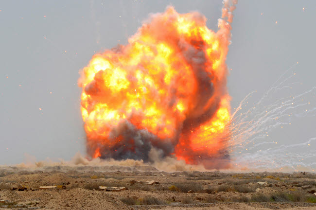 STK103823M © Stocktrek Images, Inc. A controlled detonation is set off to destroy unexploded ordnance outside Bassami, Iraq.