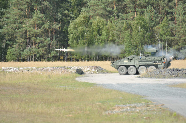 STK106246M © Stocktrek Images, Inc. Soldiers fire a TOW missile at Grafenwoehr training area.