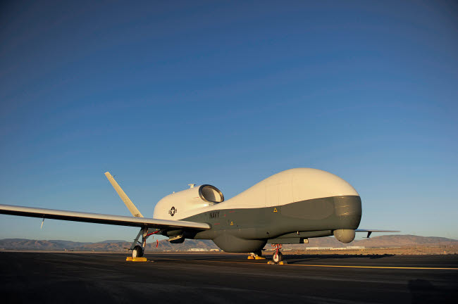 STK106263M © Stocktrek Images, Inc. An RQ-4 Global Hawk unmanned aerial vehicle sits on the flight line.