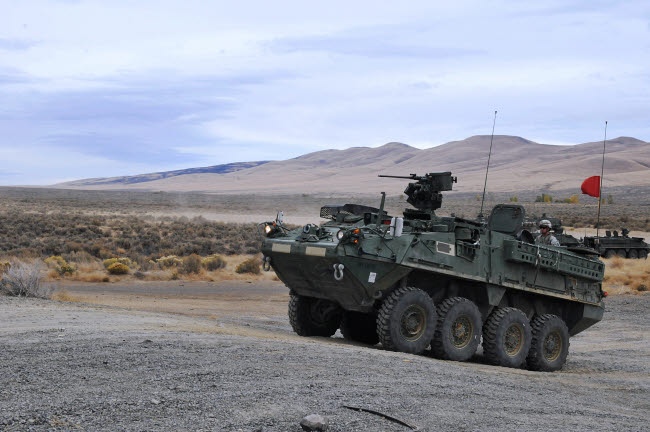 STK106548M © Stocktrek Images, Inc. Cavalry troopers fire the Stryker-mounted M2 .50-caliber machine gun.