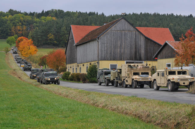 STK106871M © Stocktrek Images, Inc. Convoy of U.S. Army vehicles in Amberg, Germany.