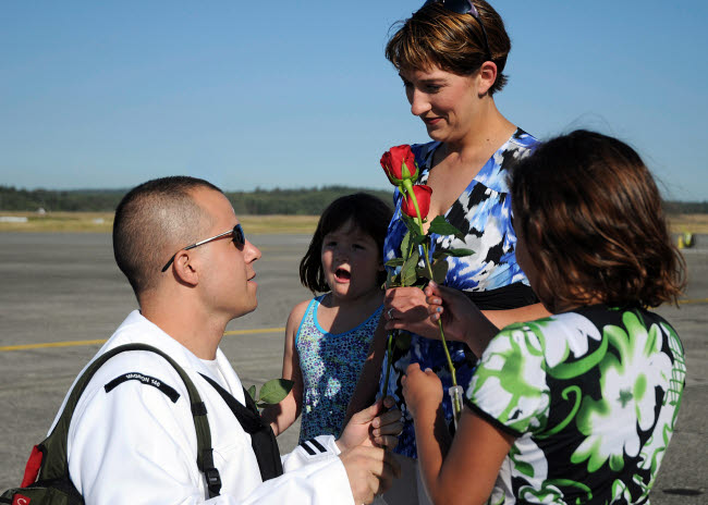 STK107964M © Stocktrek Images, Inc. U.S. Navy sailor is greeted by his wife and children during homecoming