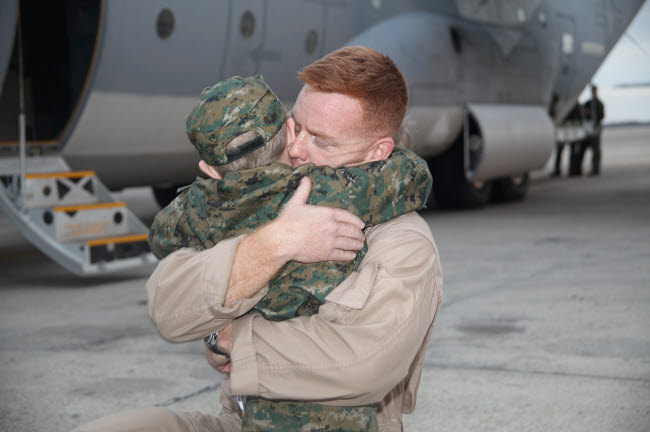 STK107974M © Stocktrek Images, Inc. U.S. Marine hugs his 4-year-old son after a deployment to Afghanistan.