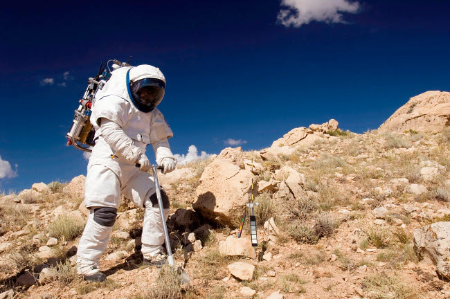 STK200010S © Stocktrek Images, Inc. Astronaut stands beside a core sampling tool.