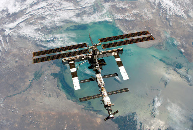 STK200163S © Stocktrek Images, Inc. The International Space Station backdropped by a colorful Earth.