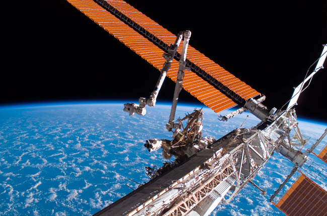 STK201556S © Stocktrek Images, Inc. The Canadarm2 and solar array panel wings on the International Space Station.