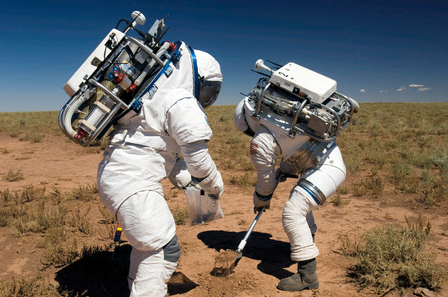 STK201836S © Stocktrek Images, Inc. Two astronauts collect soil samples during Desert RATS activity in Arizona.