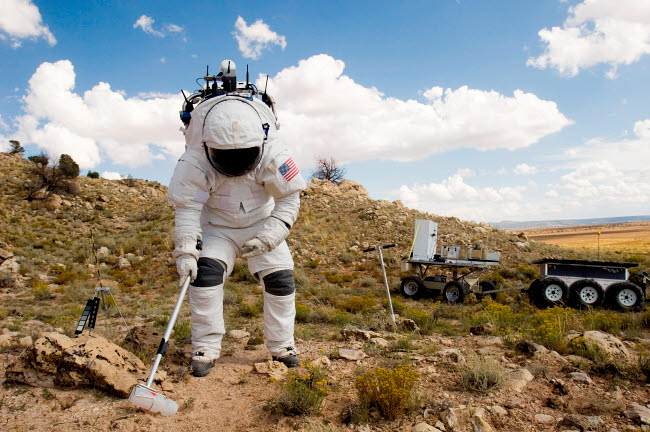STK202157S © Stocktrek Images, Inc. An astronaut collects a soil sample.