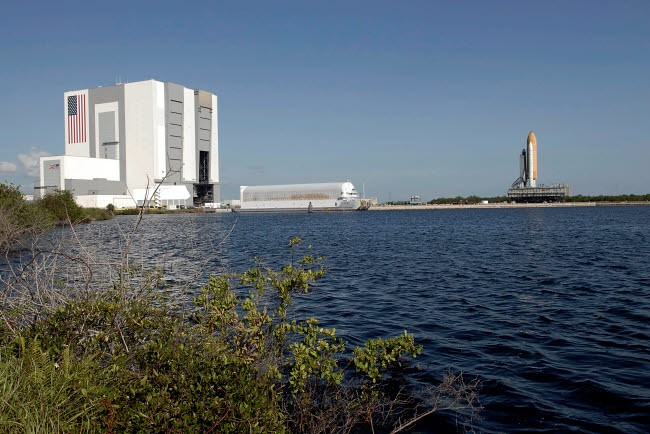 STK202604S © Stocktrek Images, Inc. Viewed across the basin, Space Shuttle Atlantis crawls toward the launch pad.