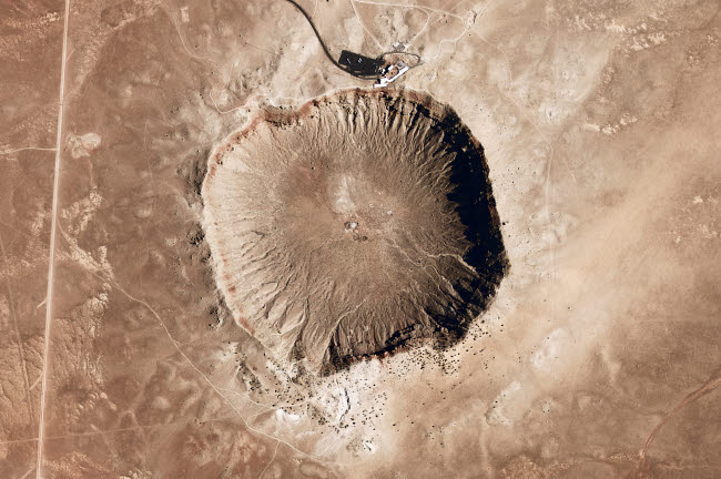 STK203455S © Stocktrek Images, Inc. A meteorite impact crater in the northern Arizona desert of the United States.