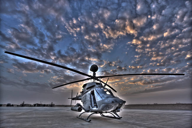 TMO100010M © Stocktrek Images, Inc. High dynamic range image of a stationary Kiowa OH-58D helicopter.