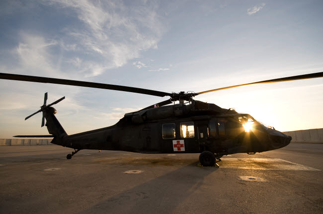 TMO100034M © Stocktrek Images, Inc. A UH-60 Blackhawk Medivac helicopter sits on the flight deck at Camp Warhorse.