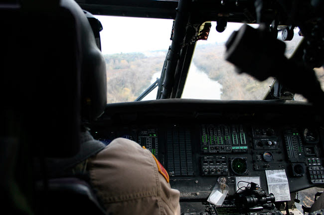 TMO100110M © Stocktrek Images, Inc. A UH-60 Blackhawk flies the river to an unknown village to drop off a care package.