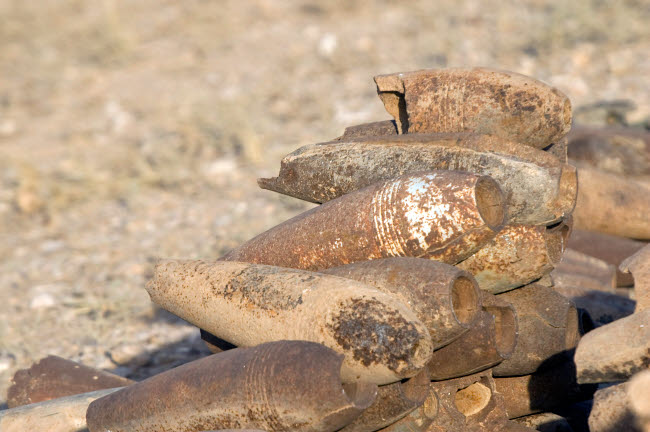 TMO100126M © Stocktrek Images, Inc. Inert artillery shells are stacked up for collection.