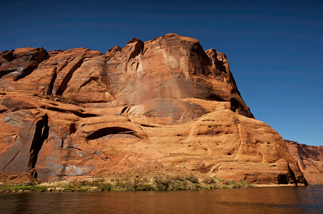 TMO200035S © Stocktrek Images, Inc. Steep cliffs guard the Colorado River near  Lees Ferry, Arizona.