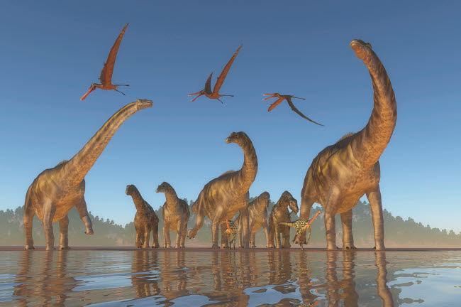 CFR200896P © Stocktrek Images, Inc. Herd of Argentinosaurus and Deinocheirus dinosaurs with a flock of Anhanguera above.