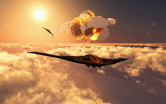 MAS101034M © Stocktrek Images, Inc. A B-2 Spirit stealth bomber flying away from its atomic bomb blast.