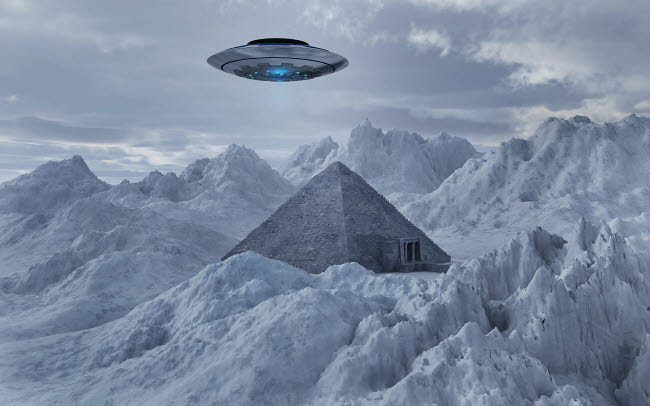 MAS200094S © Stocktrek Images, Inc. A flying saucer hovering over a pyramid in the Antarctic.