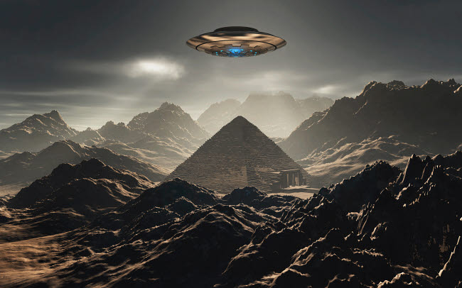 MAS200096S © Stocktrek Images, Inc. A flying saucer hovering over a pyramid in the Antarctic.