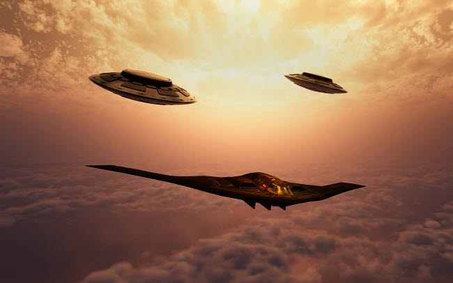 MAS200130S © Stocktrek Images, Inc. A B-2 Spirit stealth bomber being escorted by a pair of flying saucers.