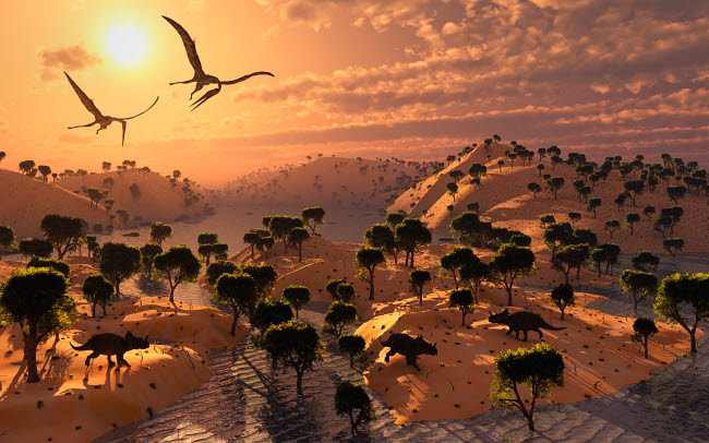 MAS600124P © Stocktrek Images, Inc. Quetzalcoatlus pterosaurs flying over a Cretaceous landscape.