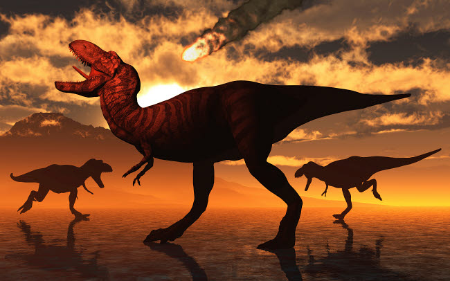 MAS600181P © Stocktrek Images, Inc. A pack of T-rex dinosaurs witness a falling asteroid.