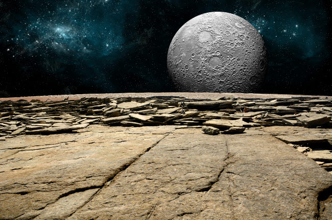 MRC200090S © Stocktrek Images, Inc. A cratered moon rises over a rocky and barren alien world.