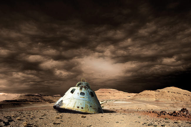MRC200191S © Stocktrek Images, Inc. A scorched space capsule lies abandoned on a barren world.