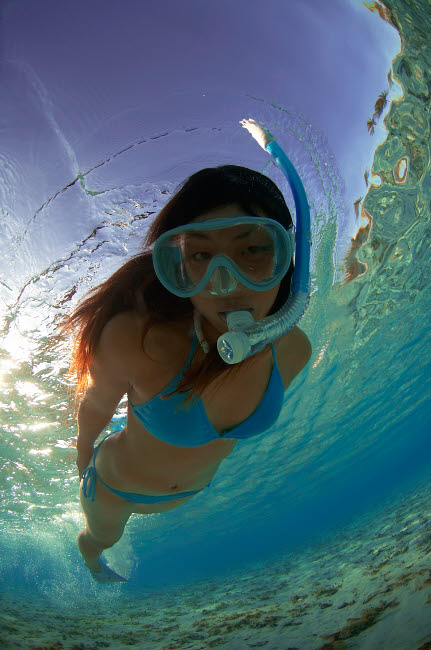 AAW400003U © Stocktrek Images, Inc. Snorkeler exploring lagoon in Bora Bora, French Polynesia.