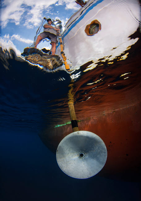 AAW400010U © Stocktrek Images, Inc. Scientist using hydrophone to listen to whale songs.