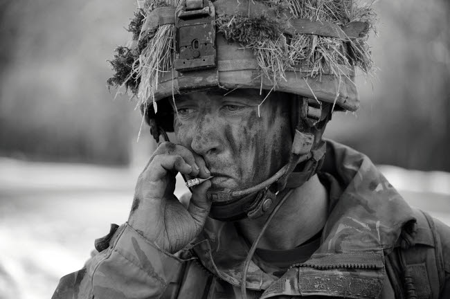 ACH100572M © Stocktrek Images, Inc. British soldier smoking a cigarette.