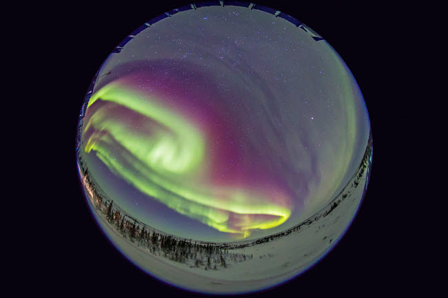 ADY200190S © Stocktrek Images, Inc. Fish-eye lens view of the northern lights in Churchill, Manitoba, Canada.